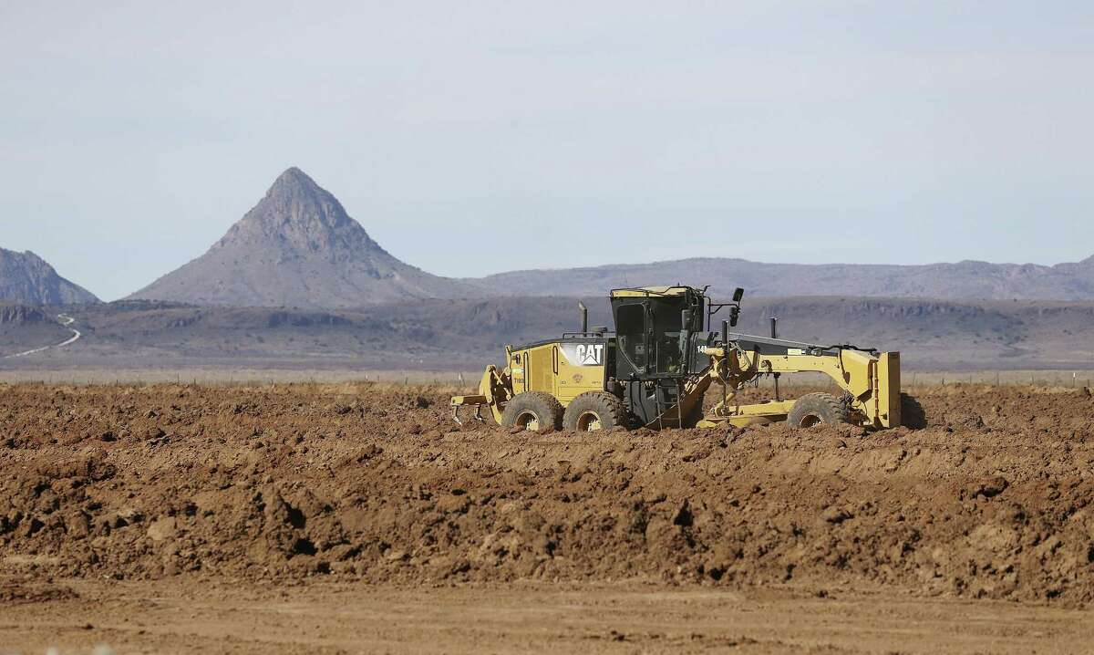 Work continues at a pad site north of Alpine, Texas, Tuesday, Dec. 8, 2015. The pad will be used for the construction of Trans-Pecos Pipeline Project. The project plans on transporting natural gas from a collection facility west of Fort Stockton into Mexico, 12 miles upriver from Presidio.