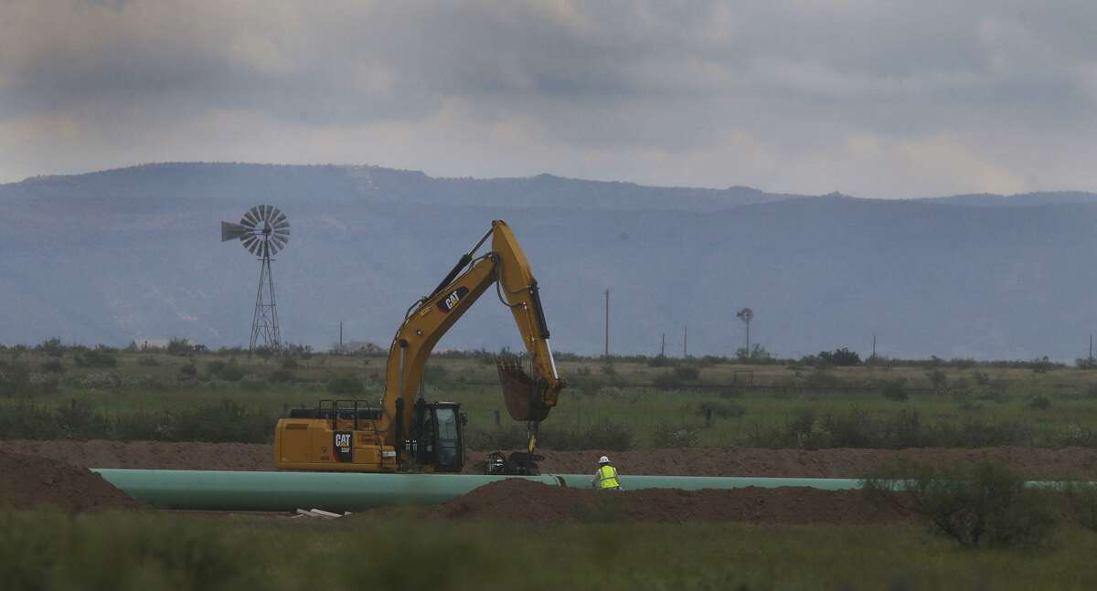 A crew works Tuesday August 30, 2016 on the new 42-inch natural gas pipeline being installed near Alpine, Texas. This portion of the pipeline is near the community of Sunny Glen just west of Alpine. The pipeline starts at the town of Coyanosa and will extend 148 miles to just 12 miles upriver on the Rio Grande from Presideo, Texas.