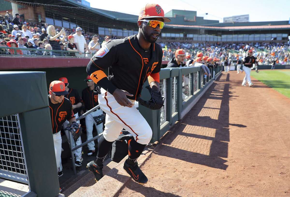 Andrew McCutchen #22 of the San Francisco Giants leaves the dugout prior to a game against the Chicago Cubs on Sunday, February 25, 2018 at Scottsdale Stadium in Scottsdale, Arizona.