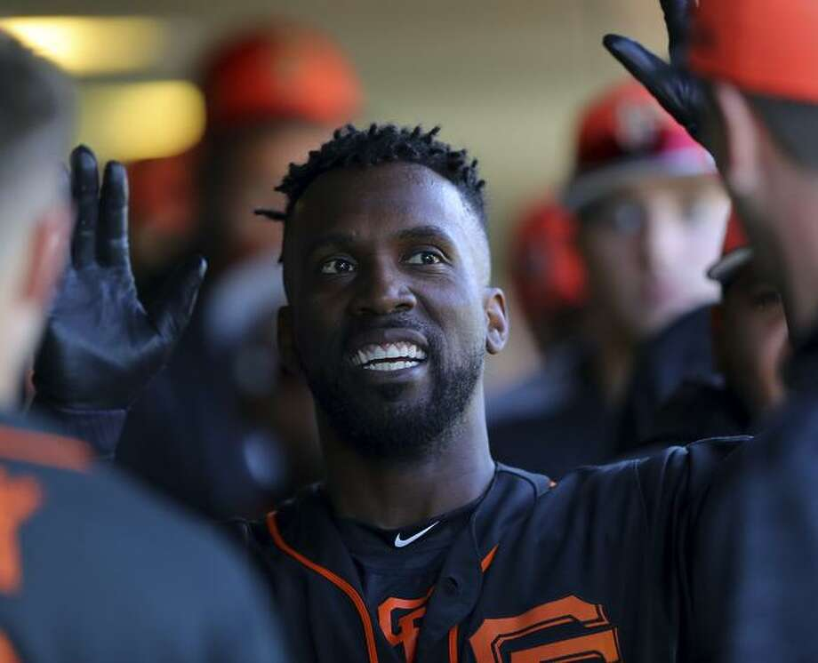 Andrew McCutchen #22 of the San Francisco Giants returns to the dugout after scoring during a game against the Chicago Cubs on Sunday, February 25, 2018 at Scottsdale Stadium in Scottsdale, Arizona. Photo: Alex Trautwig / MLB Photos Via Getty Images / 2018 Major League Baseball Photos