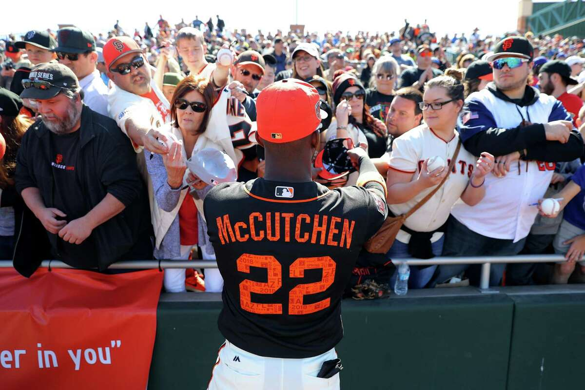Andrew McCutchen #22 of the San Francisco Giants signs autographs prior to a game against the Chicago Cubs on Sunday, February 25, 2018 at Scottsdale Stadium in Scottsdale, Arizona.