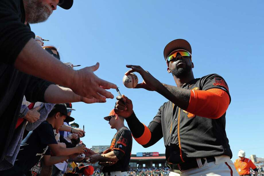 Andrew McCutchen #22 of the San Francisco Giants signs autographs prior to a game against the Chicago Cubs on Sunday, February 25, 2018 at Scottsdale Stadium in Scottsdale, Arizona. Photo: Alex Trautwig / MLB Photos Via Getty Images / 2018 Major League Baseball Photos