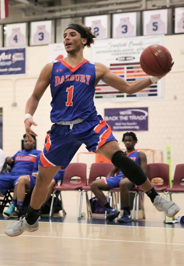 Danbury's Diante Vines leaps to recieve a pass during their game against Wilton at Wilton High School in Wilton, Conn. on Monday, February 12, 2018. Photo: Chris Palermo / For Hearst Connecticut Media / Norwalk Hour Freelance