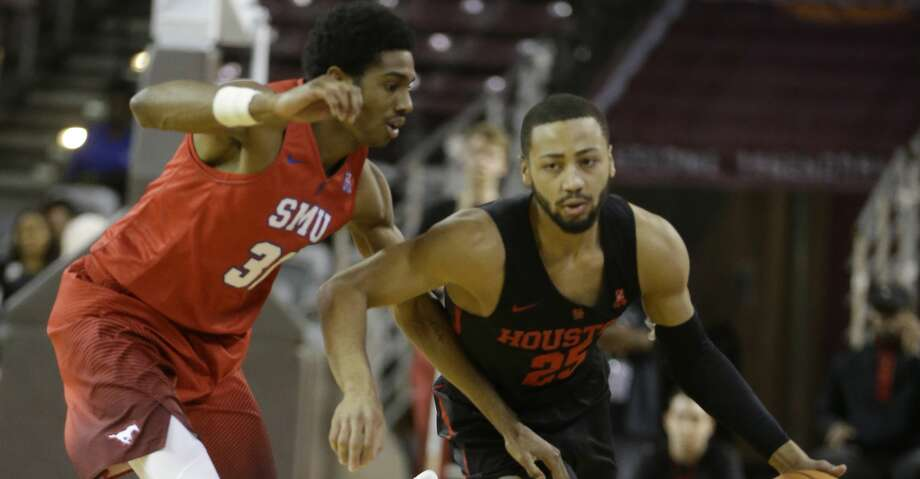 Southern Methodist University Jimmy Whitt guards University of Houston Galen Robinson Jr. during first half of game at Texas Southern University Thursday, Feb. 8, 2018, in Houston. ( Melissa Phillip / Houston Chronicle ) Photo: Melissa Phillip/Houston Chronicle