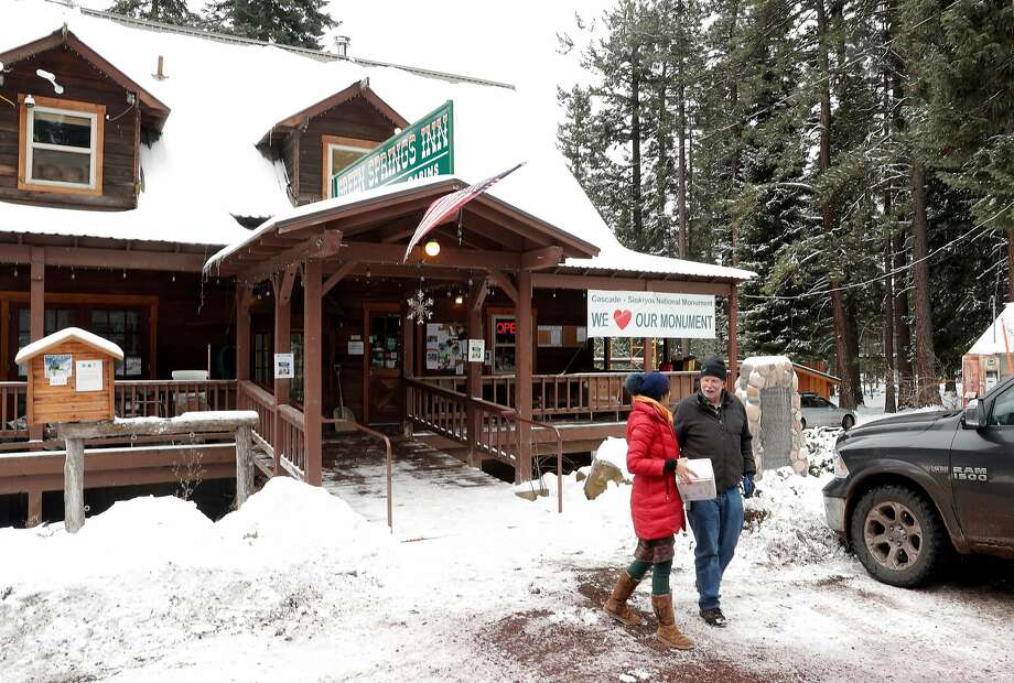 Diarmuid McGuire (right), owner of Green Springs Inn and Cabins, talking with Erika Charbeneau, favors keeping the expanded boundaries and federal protection of the Cascade-Siskiyou National Monument. Photo: Carlos Avila Gonzalez, The Chronicle