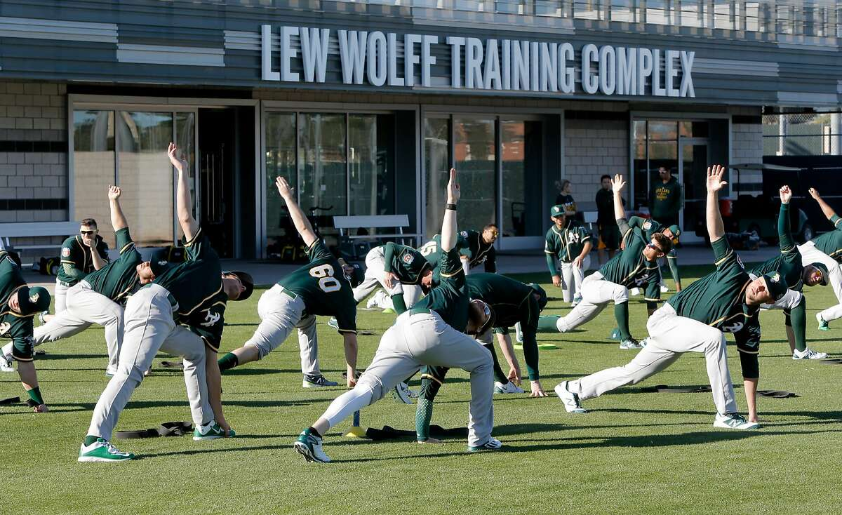 Players begin their day with yoga exercises during spring training workouts for the Oakland Athletics at the Lew Wolff Training Complex in Mesa, Arizona on Thurs. February 25, 2016.