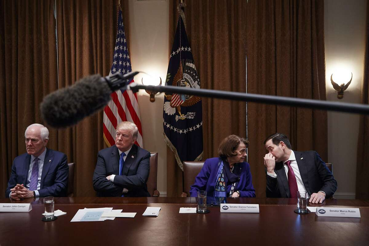 Sens. Dianne Feinstein (D-Calif.) and Marco Rubio (R-Fla.) confer during a bipartisan roundtable talk on gun control, at the White House in Washington, Feb. 28, 2018. Trump repeatedly embraced a series of gun control measures here Monday. From left: Sen. John Cornyn (R-Texas); President Donald Trump; Feinstein and Rubio. (Tom Brenner/The New York Times)