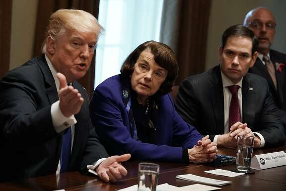 WASHINGTON, DC - FEBRUARY 28:  (L-R) U.S. President Donald Trump speaks as Sen. Dianne Feinstein (D-CA), Sen. Marco Rubio (R-FL) and Rep. Ted Deutch (D-FL) listen during a meeting with bipartisan members of the Congress at the Cabinet Room of the White House February 28, 2018 in Washington, DC. President Trump held a meeting with lawmakers to discuss school and community safety.  (Photo by Alex Wong/Getty Images)