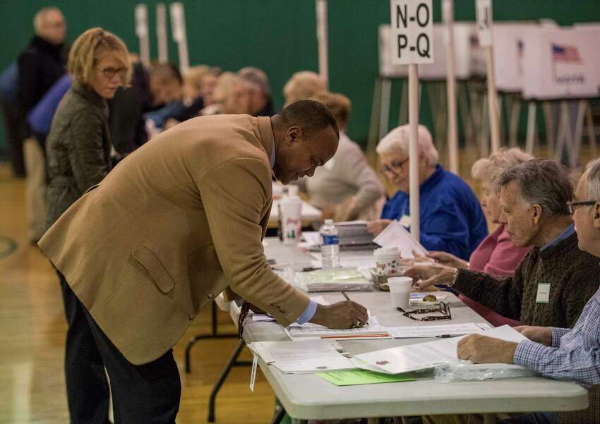 L. Oliver Robinson, Shenedehowa Superintendent of Schools checks in as the polls open at the Gowana Middle School for the land deal vote Tuesday Dec 5, 2017 in Clifton Park, NY. (Skip Dickstein/ Times Union archive)