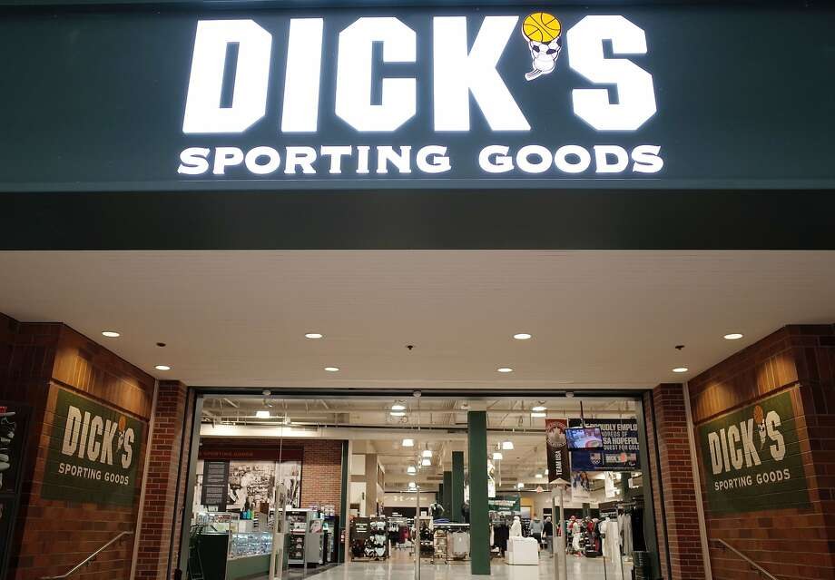 Dick's Sporting Goods stores will end the sales of all assault rifles and will not sell any guns to people who are under 21. Photo: ROBYN BECK, AFP/Getty Images