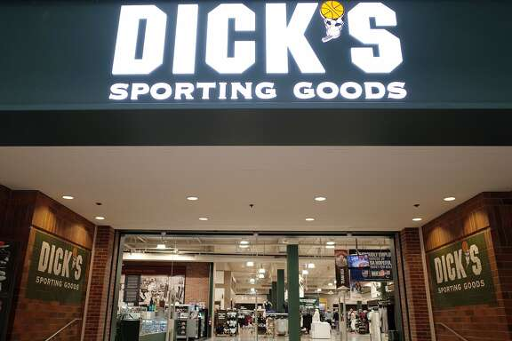 The entrance to the Dick's Sporting Goods store is seen in Glendale, California on February 28, 2018.   Dick's, one of the nation's largest sports retailers, said February 28 that it was immediately ending sales of all assault-style rifles in its stores. The retailer also said that it would no longer sell high-capacity magazines and that it would not sell any gun to anyone under 21 years of age, regardless of local laws. / AFP PHOTO / Robyn BeckROBYN BECK/AFP/Getty Images