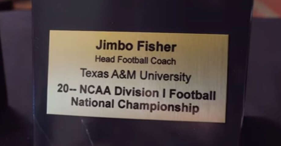 Texas A&M chancellor John Sharp awarded coach Jimbo Fisher a national championship plaque - of the future. Photo: A&M