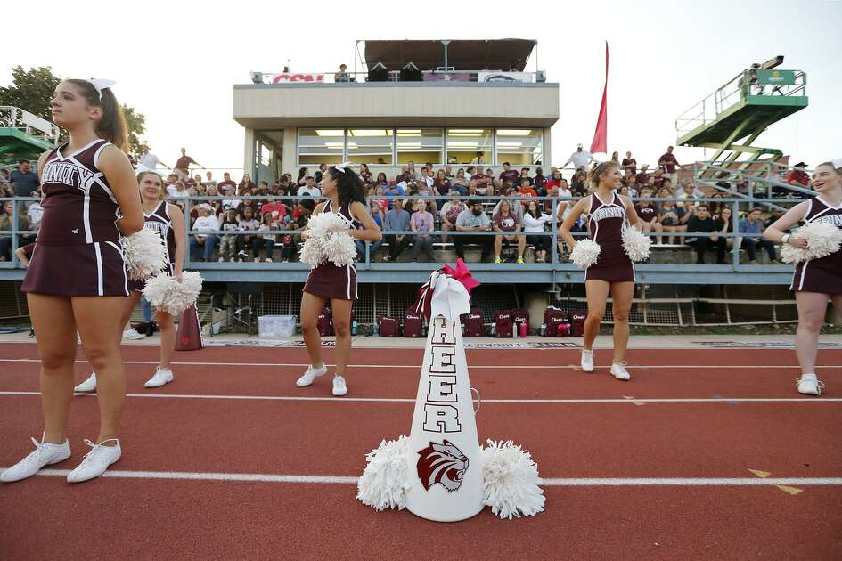Trinity University cheerleaders stand near a white megaphone for Trinity University student and cheerleader Cayley Mandadi, 19, during the Trinity football came against Austin College held Saturday Nov 4, 2017 at Trinity University. Mandadi died Tuesday Oct. 31, 2017 at a hospital in Kyle.