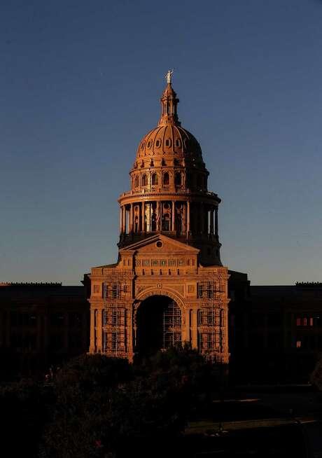The sun sets over the Texas Capitol in Austin. ( Jon Shapley / Houston Chronicle ) Photo: Jon Shapley, Staff / Houston Chronicle / Internal