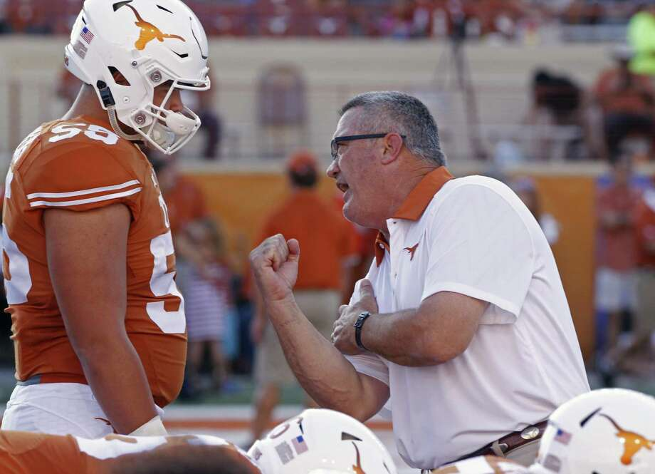 Offensive line coach Joe Wickline, right, works with Texas lineman Connor Williams before the start of an NCAA college football game between Rice and Texas, Saturday, Sept. 12, 2015, in Austin, Texas. (AP Photo/Michael Thomas) Photo: Michael Thomas, FRE / Associated Press / FR65778 AP