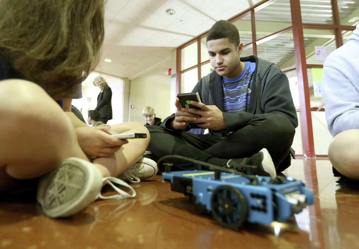 Reagan High School sophomore Dario Eubanks works Wednesday, Feb. 28, 2018 to program a Texas Instruments rover during a STEM day event sponsored by TI.