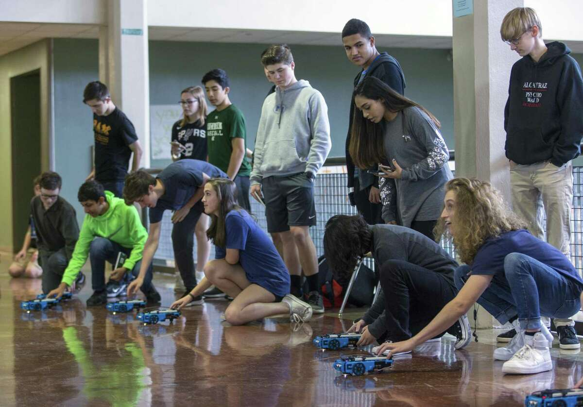 Reagan High School students in pre-AP Computer Science prepare Wednesday, Feb. 28, 2018 to to watch their Texas Instruments rovers run the commands they programmed into them during a STEM day event sponsored by TI.