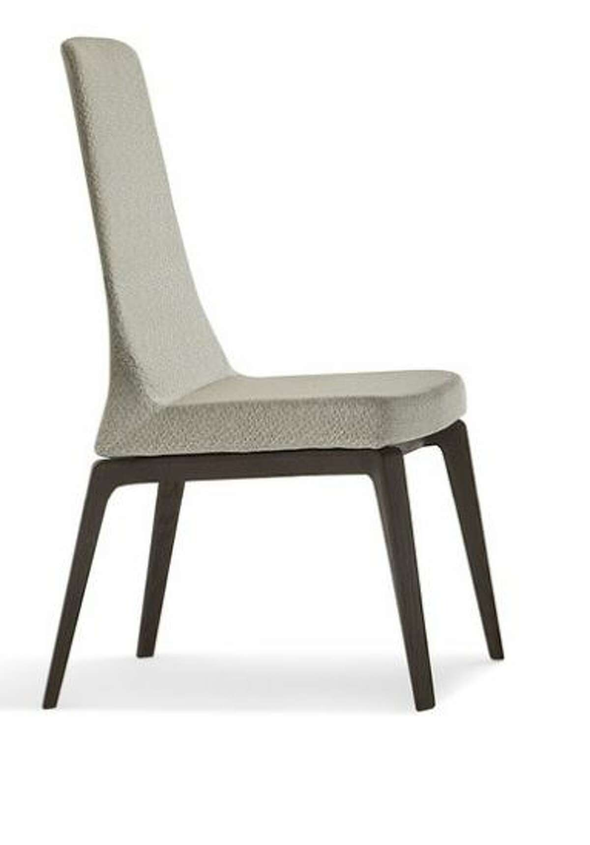 Giorgetti's Ala dining chair starts at $1,200. Feel free to upgrade to executive dining leather.