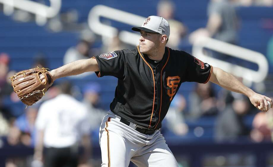 San Francisco Giants pitcher Ty Blach throws during the first inning of a spring training baseball game against the Milwaukee Brewers, Wednesday, Feb. 28, 2018, in Maryvale, Ariz. (AP Photo/Carlos Osorio) Photo: Carlos Osorio / Associated Press