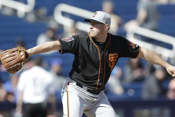 San Francisco Giants pitcher Ty Blach throws during the first inning of a spring training baseball game against the Milwaukee Brewers, Wednesday, Feb. 28, 2018, in Maryvale, Ariz. (AP Photo/Carlos Osorio)
