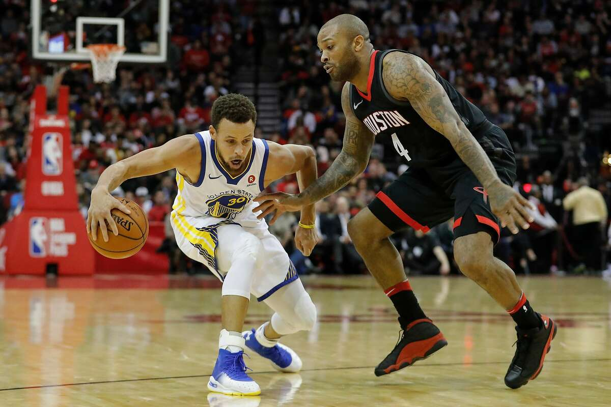 HOUSTON, TX - JANUARY 04: Stephen Curry #30 of the Golden State Warriors dribbles the ball in the second half defended by PJ Tucker #4 of the Houston Rockets at Toyota Center on January 4, 2018 in Houston, Texas. NOTE TO USER: User expressly acknowledges and agrees that, by downloading and or using this Photograph, user is consenting to the terms and conditions of the Getty Images License Agreement. (Photo by Tim Warner/Getty Images)
