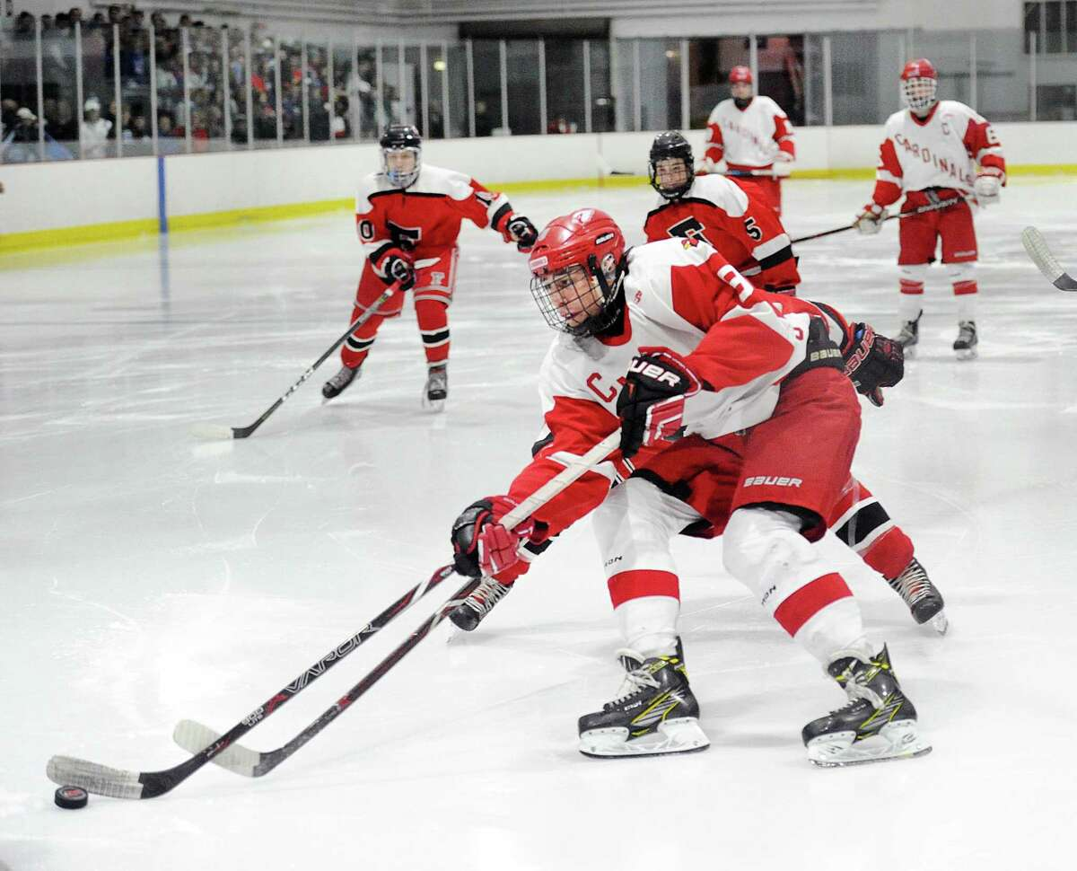 Greenwich's Alex Mozian beats everyone down the ice and gets off a shot that beats Fairfield goalie Dawson Gunn (not in photo) for a goal in the second period.