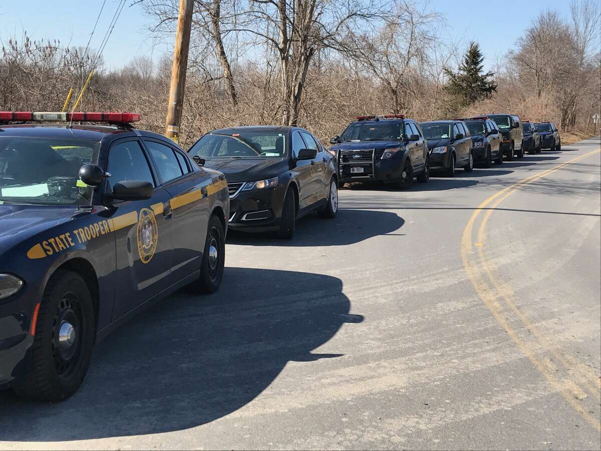State Police cars are parked along Maloney Road in Wappinger, Dutchess County, as troopers investigate the discovery of a woman's body in a stream on Feb. 27, 2018.