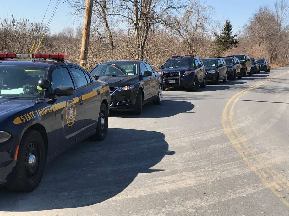 State Police cars are parked along Maloney Road in Wappinger, Dutchess County, as troopers investigate the discovery of a woman's body in a stream on Feb. 27, 2018. Photo: State Police