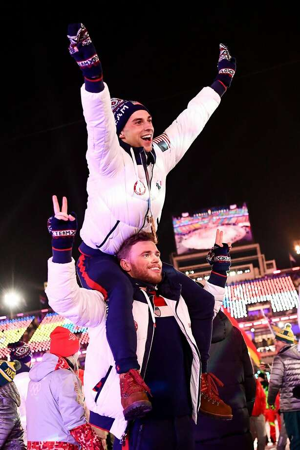 US athletes Adam Rippon and Gus Kenworthy parade with other delegations during the closing ceremony of the Pyeongchang 2018 Winter Olympic Games. Photo: JONATHAN NACKSTRAND, AFP/Getty Images