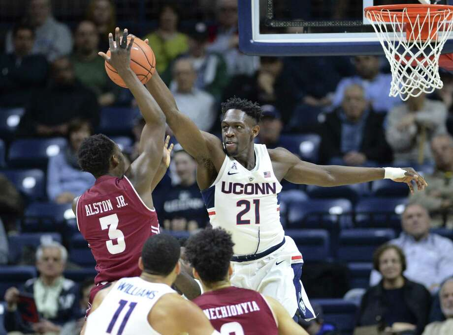 UConn's Mamadou Diarra blocks a shot by Temple's Shizz Alston Jr. in the first half of Wednesday's contest in Storrs. Photo: Stephen Dunn / Associated Press / FR171426 AP