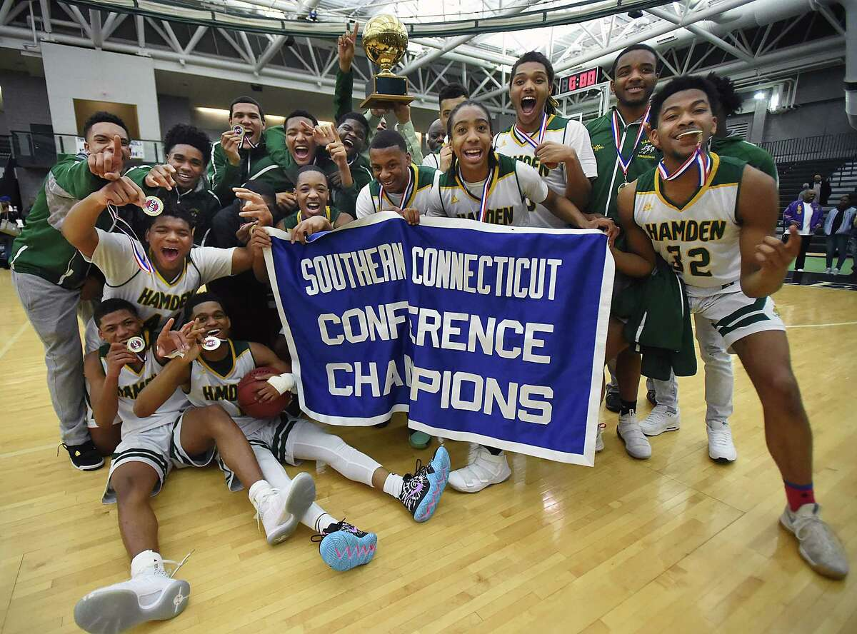 Hamden celebrates their SCC championship win, defeating Hillhouse 67-49, Wednesday, Feb. 28, 2018, at the Floyd Little Athletic Center in New Haven.
