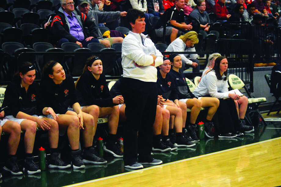 Edwardsville coach Lori Blade, standing, looks on from the sideline during her team's game against Mother McAuley in the Illinois Wesleyan Super-Sectional on Monday.