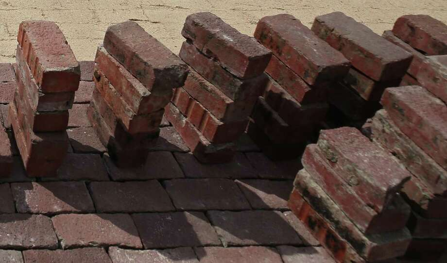 Historic bricks, hand made by founders of Houston's Freedman's Town, were reinstalled last week at the corner of Andrews and Genessee streets after they had been removed in 2016 for storm drainage work. Photo: Godofredo A. Vasquez, Houston Chronicle / Houston Chronicle / Godofredo A. Vasquez