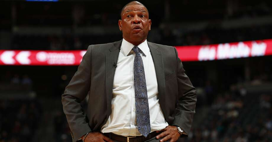 """PHOTOS: Rockets game-by-game""""We're going to build a wall,"""" Doc Rivers said. """"And Houston is going to pay for it.""""Browse through the photos to see how the Rockets have fared through each game this season. Photo: David Zalubowski/Associated Press"""
