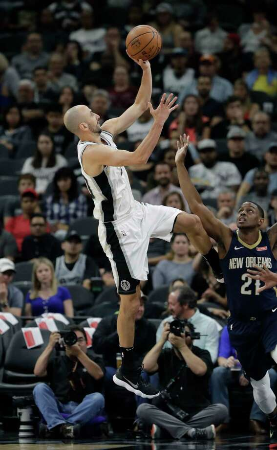 San Antonio Spurs guard Manu Ginobili (20) shoots over New Orleans Pelicans forward Darius Miller (21) during the first half of an NBA basketball game Wednesday, Feb. 28, 2018, in San Antonio. (AP Photo/Eric Gay) Photo: Eric Gay, Associated Press / Copyright 2018 The Associated Press. All rights reserved.