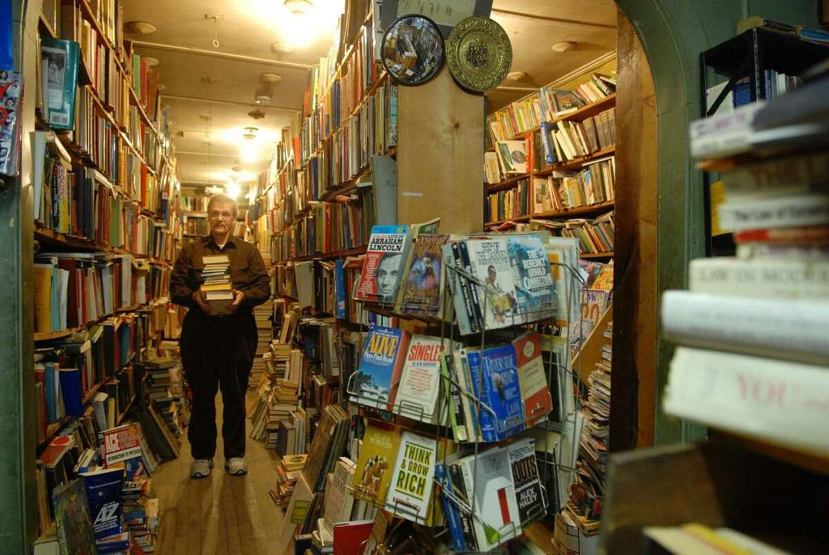 Kenneth Weden, owner, stands in his store, Capital Bookstore on Broadway in Albany. (Paul Buckowski / Times Union)