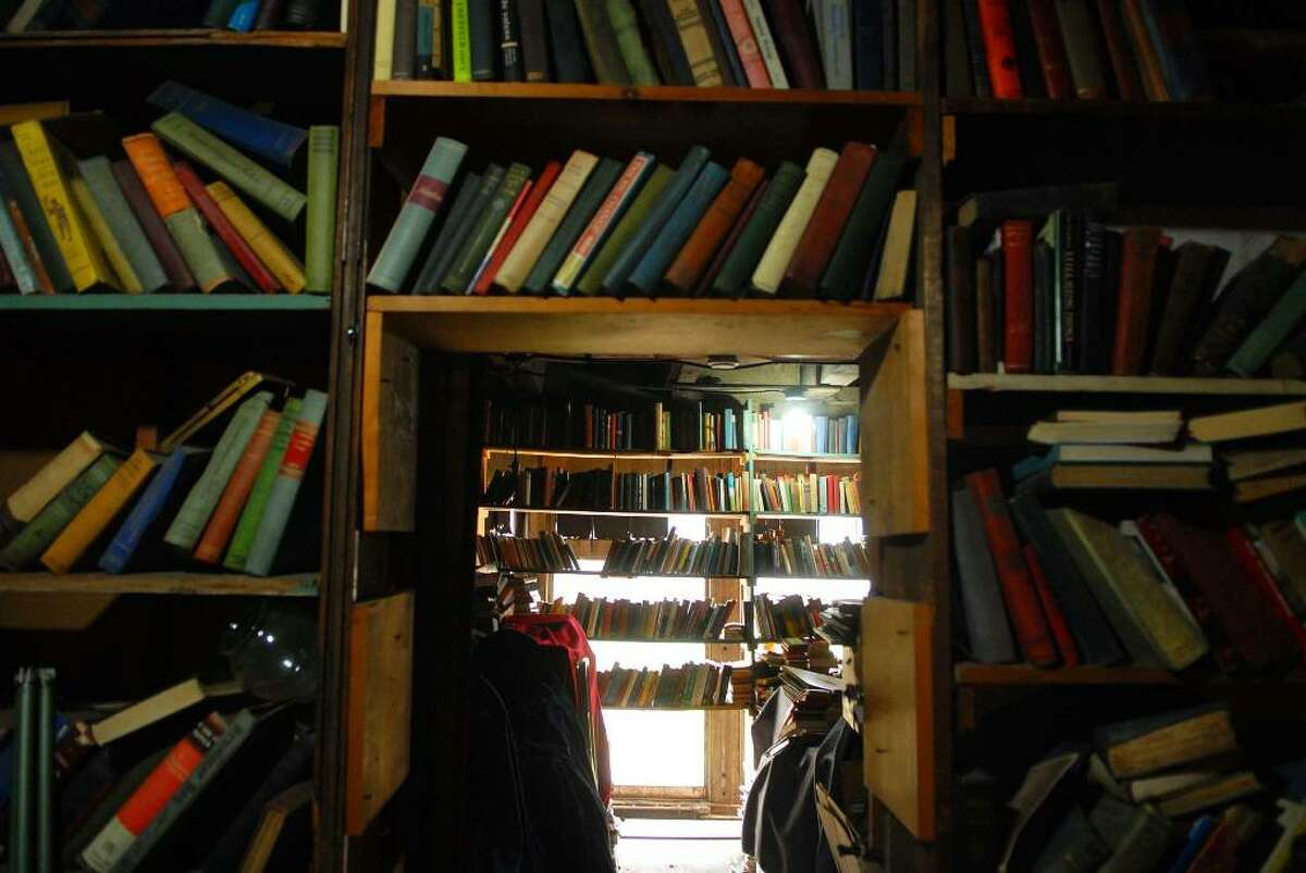 On the second floor much like the first floor books are stored all over on shelves inside Capital Bookstore on Broadway in Albany. (Paul Buckowski / Times Union)