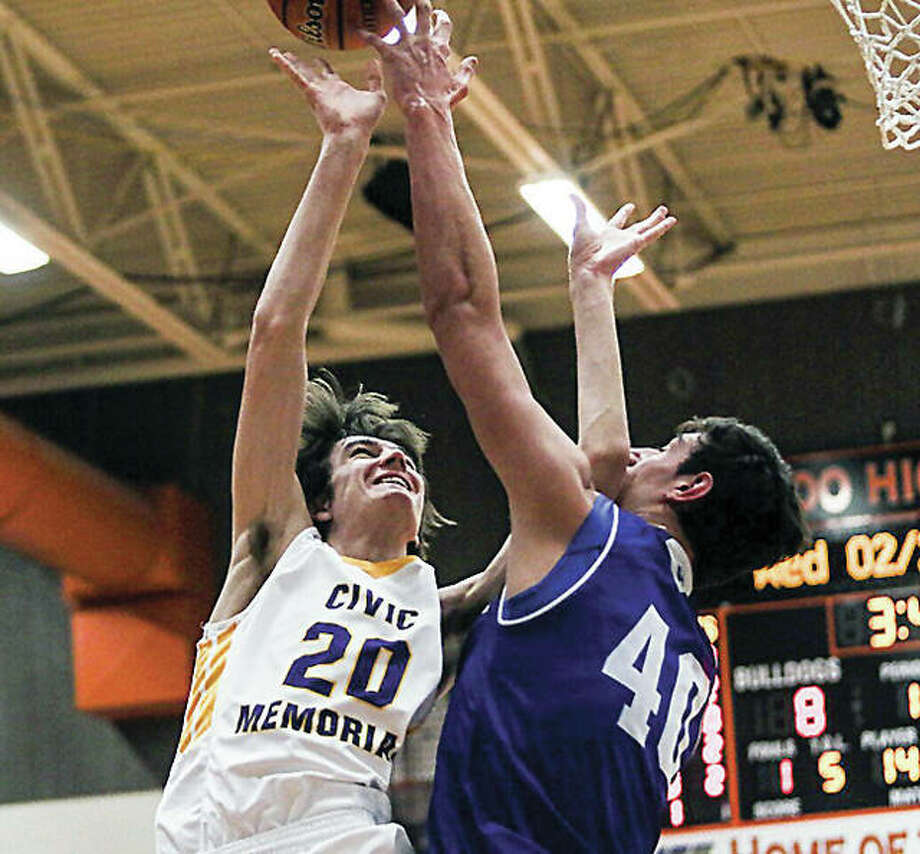 Civic Memorial's Will Buhs (20) puts up a shot against Columbia Cole Khoury during Wednesday night's Class 3A regional semifinal in Waterloo. Photo: Nathan Woodside | For The Telegraph