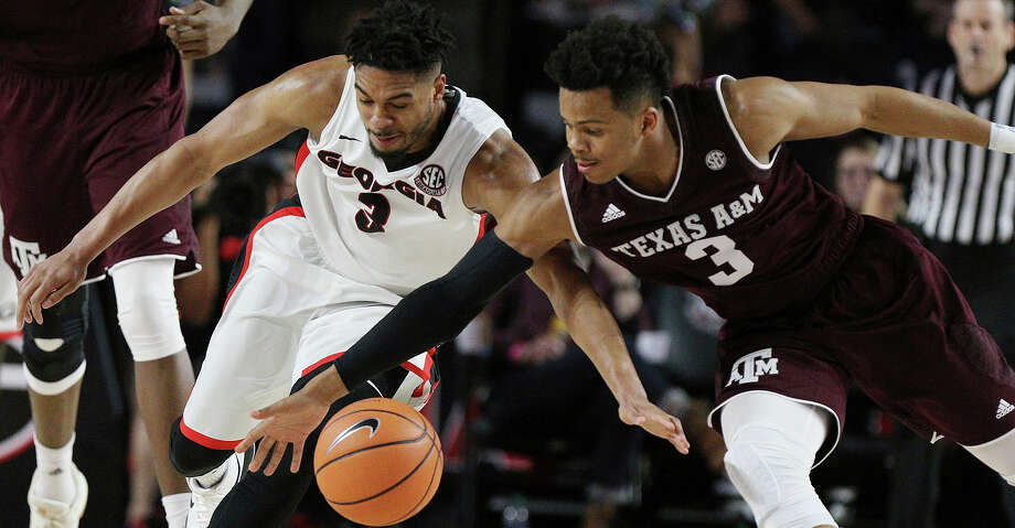 Georgia guard Juwan Parker, left, and Texas A&M guard Adam Gilder race for a loose ball during an NCAA college basketball game Wednesday, Feb. 28, 2018, in Athens, Ga. Texas A&M won 61-60. (Curtis Compton/Atlanta Journal-Constitution via AP) Photo: Curtis Compson/Associated Press