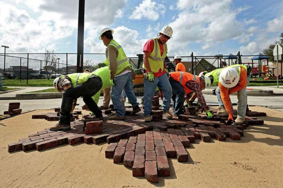 Houston Public Works crews re-install the historic bricks on the corner of Andrews and Genesee streets in Freedman's Town Wednesday, Feb. 28, 2018, in Houston. Photo: Godofredo A. Vasquez, Houston Chronicle / Godofredo A. Vasquez