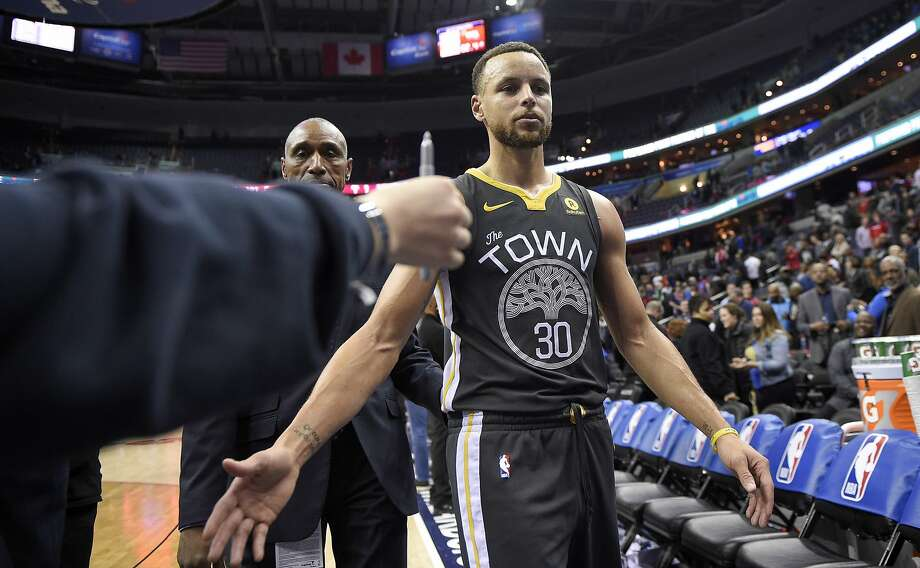 Golden State Warriors guard Stephen Curry (30) leaves the court after the team's NBA basketball game against the Washington Wizards, Wednesday, Feb. 28, 2018, in Washington. The Warriors won 109-101. (AP Photo/Nick Wass) Photo: Nick Wass, Associated Press