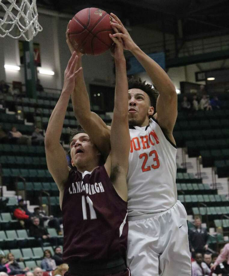Mohonasen's Avery Deas battles for a rebound with Lansingburgh's Trevor Green during the Section II Class A boys' basketball semifinal at the Cool Insuring Arena in Glens Falls, NY Wednesday, Feb. 28, 2018. (Ed Burke-Special to The Times Union)