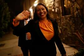 London Breed, President of the San Francisco Board of Supervisors and mayoral candidate, waves as she arrives for a roundtable discussion at the United Irish Cultural Center in San Francisco, Calif. on Wednesday, Feb. 28, 2018.