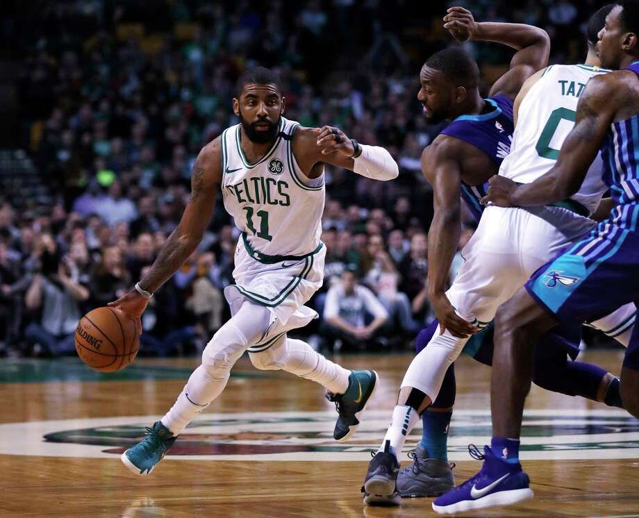 Boston Celtics guard Kyrie Irving (11) cuts to the basket as forward Jayson Tatum (0) traps Charlotte Hornets guard Kemba Walker during the first quarter of an NBA basketball game in Boston, Wednesday, Feb. 28, 2018. (AP Photo/Charles Krupa) Photo: Charles Krupa / Copyright 2018 The Associated Press. All rights reserved.