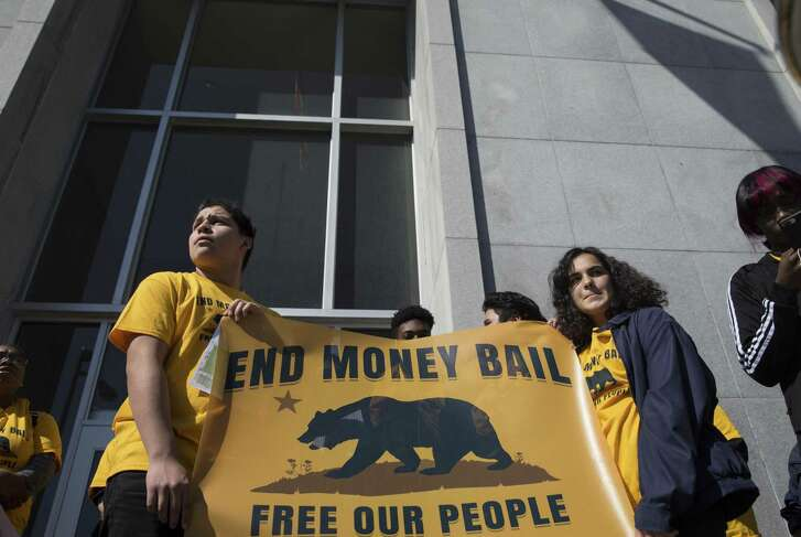 Supporters and activists gather on the steps of the Hall of Justice in San Francisco during a rally calling for the end of the money bail system on Tuesday, February 20, 2018.