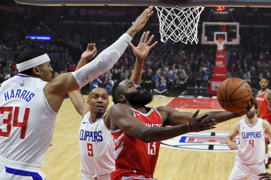 Houston Rockets guard James Harden, right, shoots as Los Angeles Clippers forward Tobias Harris, left, and guard C.J. Williams defend during the first half of an NBA basketball game Wednesday, Feb. 28, 2018, in Los Angeles. (AP Photo/Mark J. Terrill) Photo: Mark J. Terrill/Associated Press