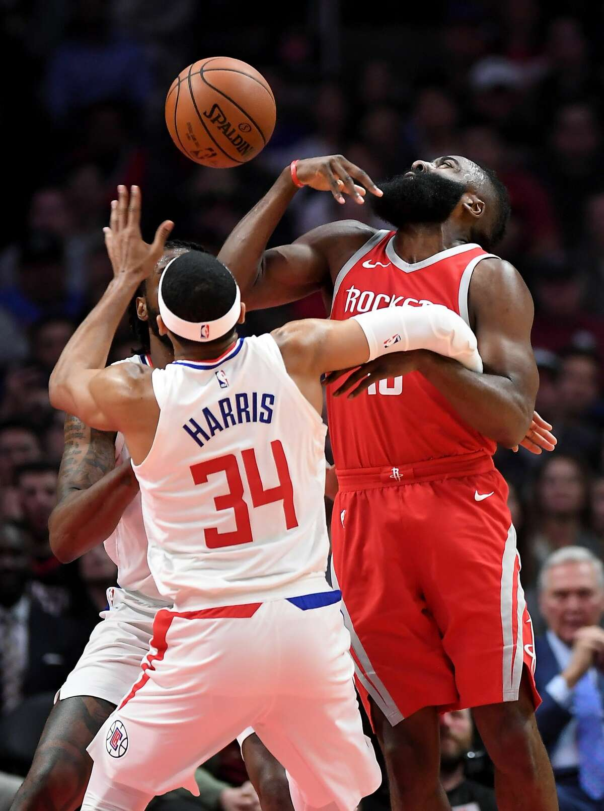 The Houston Rockets' James Harden, right, is fouled by the Los Angeles Clippers' Tobias Harris (34) while attempting a shot in the first quarter at the Staples Center in Los Angeles on Wednesday, Feb. 28, 2018. (Wally Skalij/Los Angeles Times/TNS)