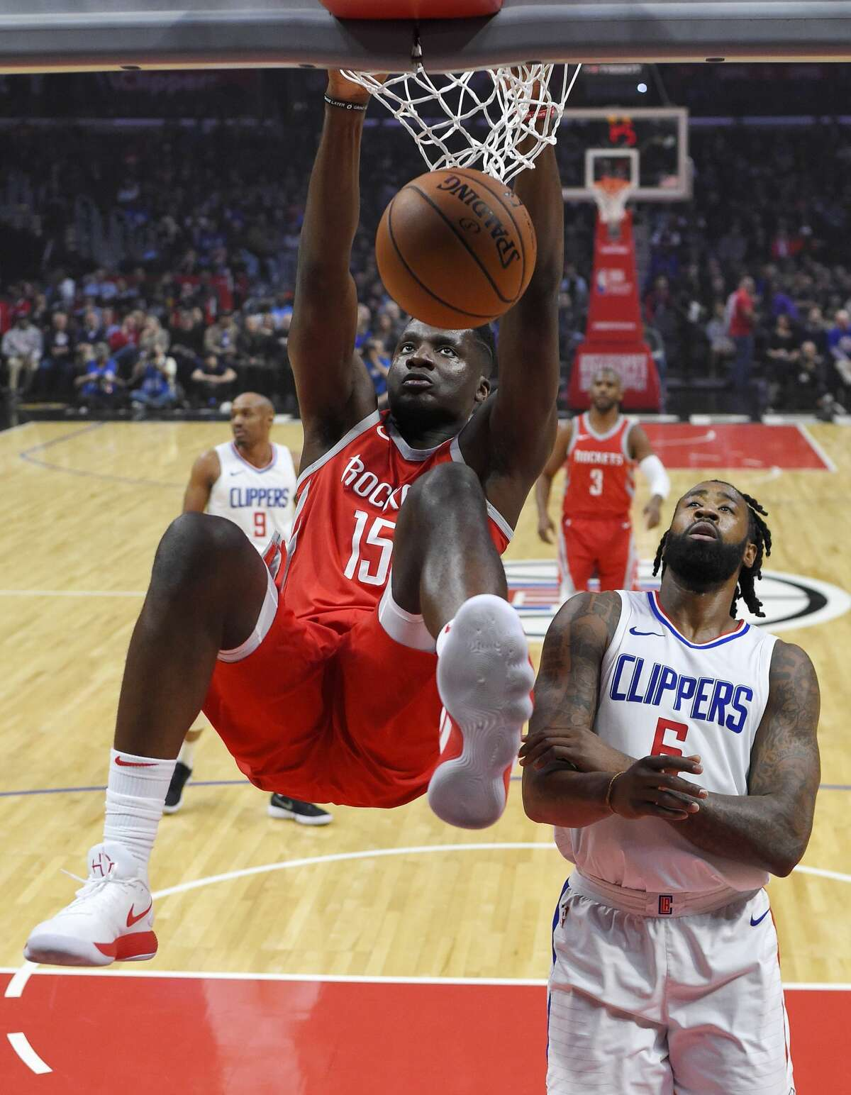 Houston Rockets center Clint Capela, left, dunks as Los Angeles Clippers center DeAndre Jordan defends during the first half of an NBA basketball game Wednesday, Feb. 28, 2018, in Los Angeles. (AP Photo/Mark J. Terrill)