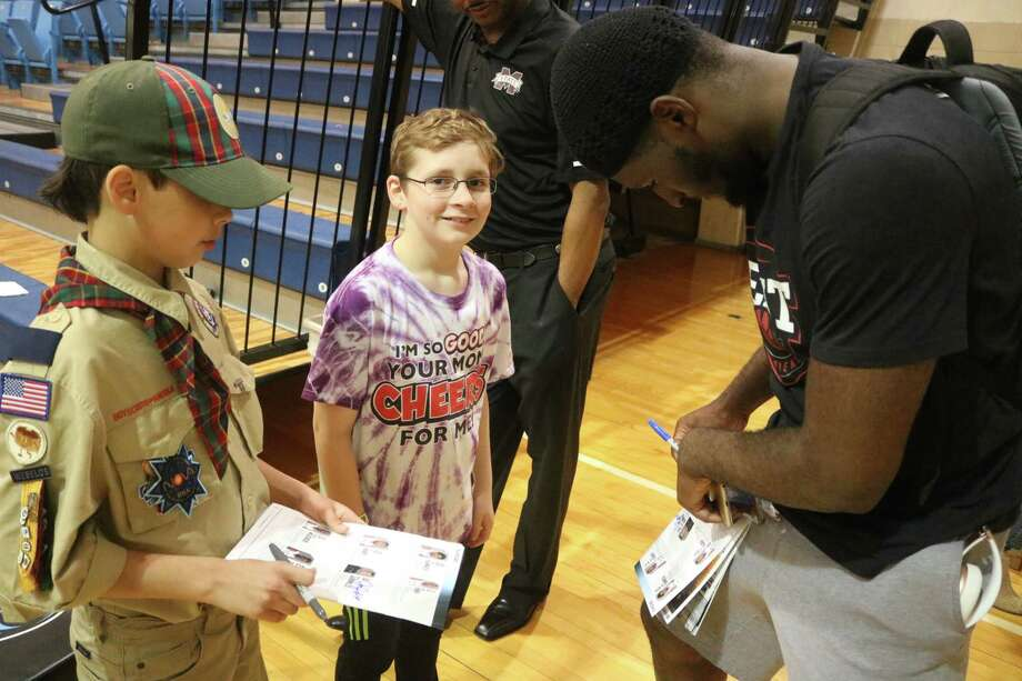The last autograph signings at Anders Gym Wednesday night had Kabir Mohammed signing Nicholas Brown's San Jac media guide. Photo: Robert Avery