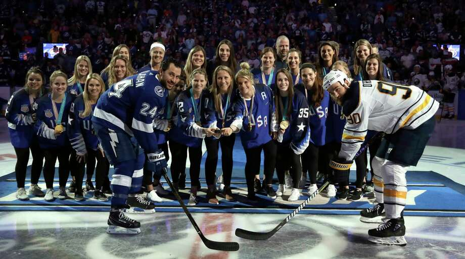 Members of the U.S. women's gold medal-winning hockey team drop the ceremonial puck for Tampa Bay Lightning right wing Ryan Callahan (24) and Buffalo Sabres center Ryan O'Reilly (90) before an NHL hockey game Wednesday, Feb. 28, 2018, in Tampa, Fla. (AP Photo/Chris O'Meara) Photo: Chris O'Meara / Copyright 2018 The Associated Press. All rights reserved.